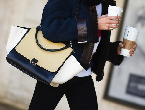 Using bright handbags along with wearing dark jeans